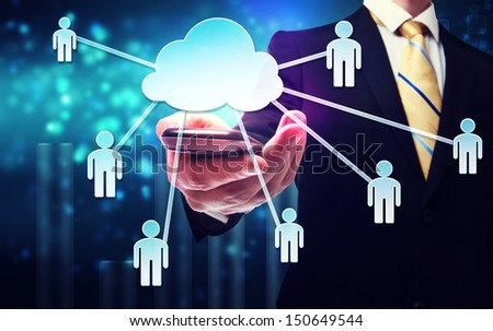 Business man with cloud computing connection concept on blue technology background - stock photo