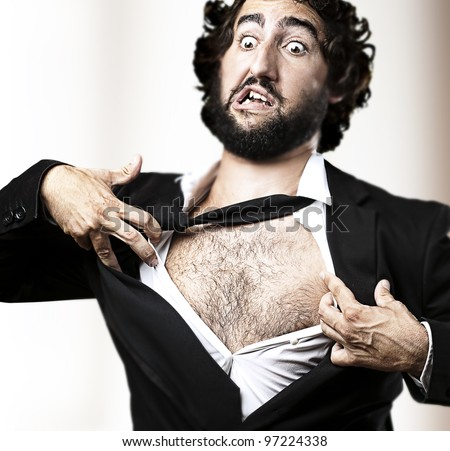 business man with courage and superman concept tearing off his shirt against an abstract background - stock photo