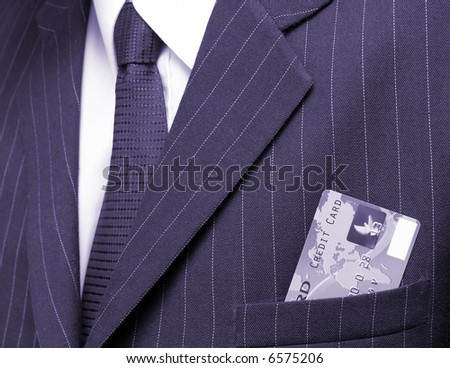 business man with credit card in his pocket