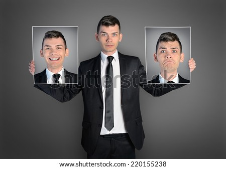 Business man with different faces - stock photo