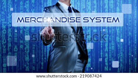 Business man with digital background pressing on button merchandise system - stock photo