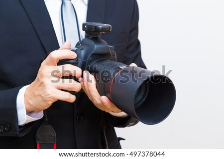 Business man with dslr camera in black suit close up, Professional photographer