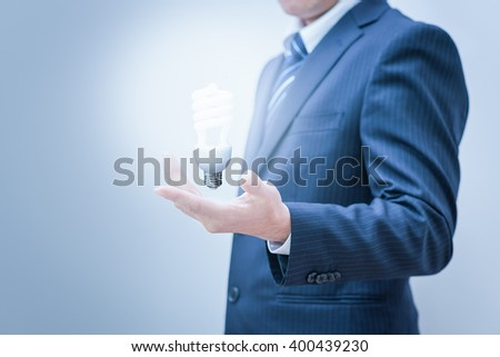 Business man with empty hand. Hand Holding a Light.  - stock photo