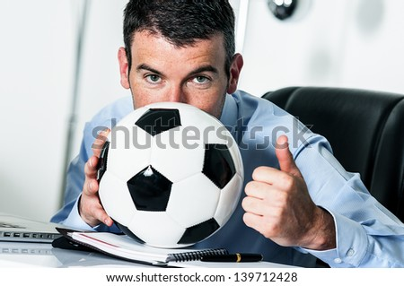 Business man with football - stock photo
