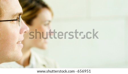 Business man with glasses and business woman looking with vision - stock photo
