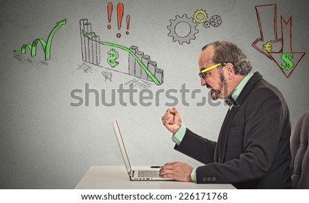 Business man with glasses working on computer upset anticipation of financial crisis bad poor economy isolated grey wall background. Corporate employee pissed of with stock market result decision made - stock photo