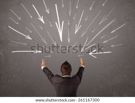 Business man with hand drawn arrows pointing at his head concept - stock photo