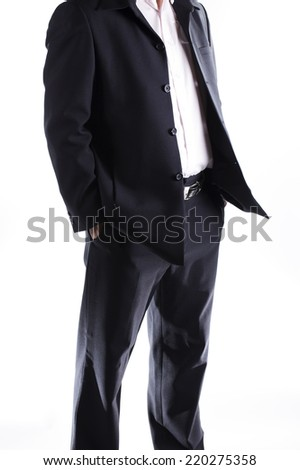 business man with hands in his pockets isolated on white background