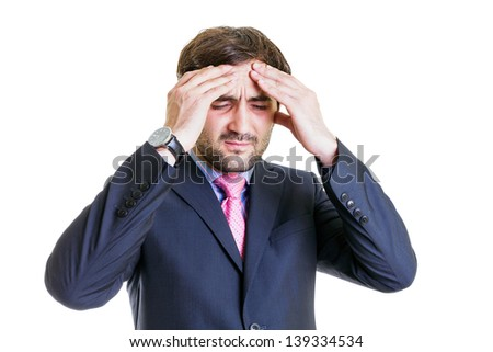 Business man with head ache massaging his head, isolated on white - stock photo