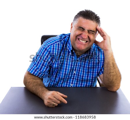 Business man with headache in his office - stock photo