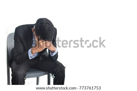 Business man with headache on white background
