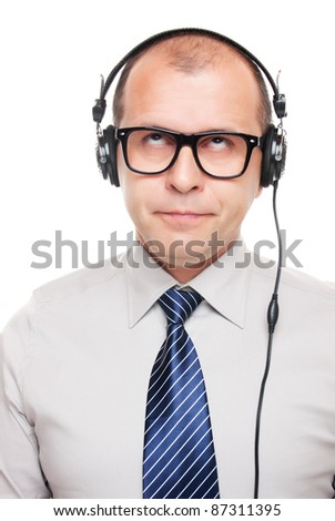 Business man with headphones isolated on white background