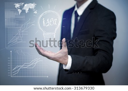 business man with idea lamp on his hand,Idea concept
