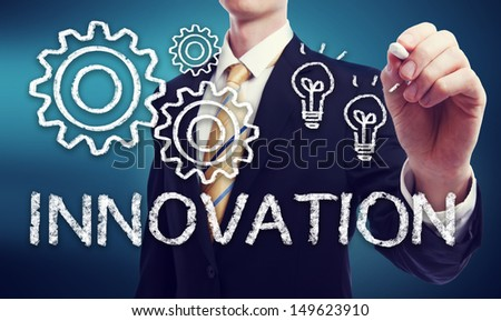 Business Man with Innovation Concept with Light Bulbs and Gears  - stock photo
