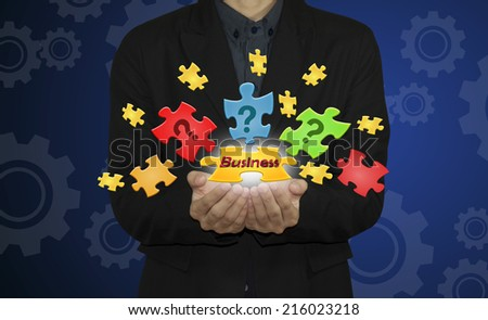 Business man with  jigsaw puzzle piece. - stock photo