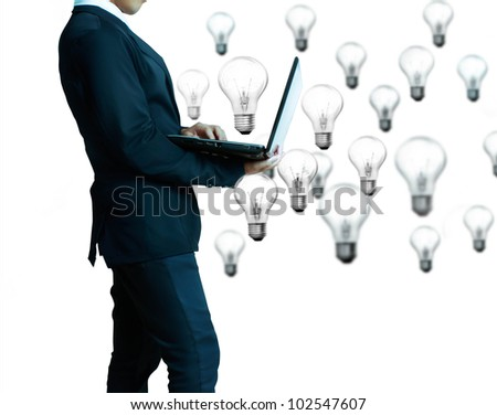 business man with laptop ands Light bulbs isolated on white background