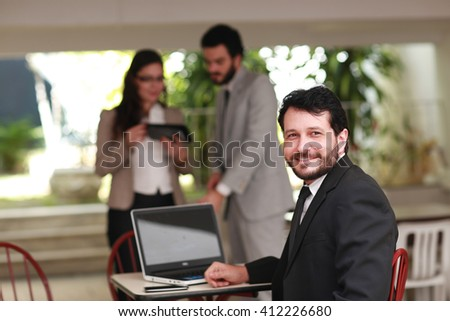 business man with laptop in the open space