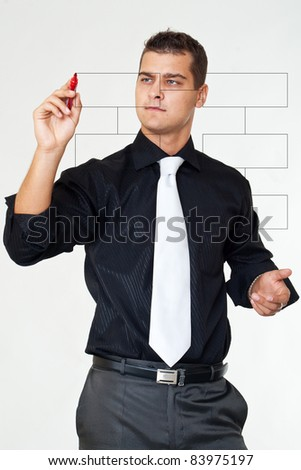 Business man  with marker  writes diagrams - stock photo