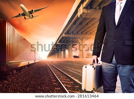 business man with metal briefcase investment  standing against air palne ,trains and ship port  transport and logistic background - stock photo