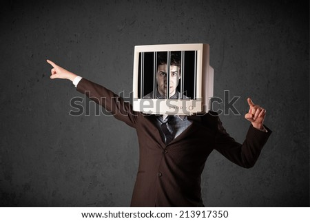 Business man with monitor screen on his head traped into a digital system concept - stock photo