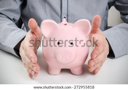 Business man with piggy bank. Saving money concept - stock photo