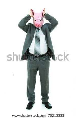 Business man with piggy mask closing his ears - stock photo