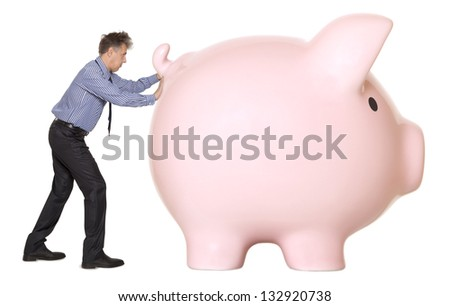 Business man with pink piggy bank on the white background - stock photo