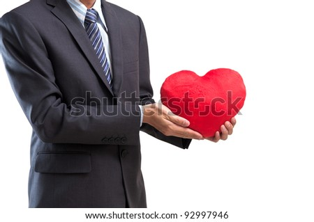 Business man with red heart isolated on white