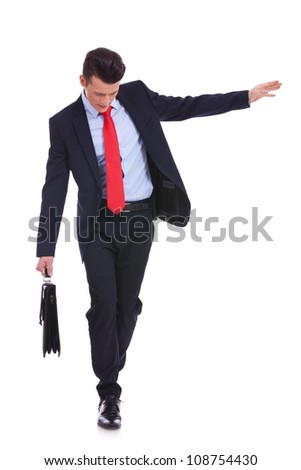 Business man with slow walking with fear from falling, isolated on white - stock photo