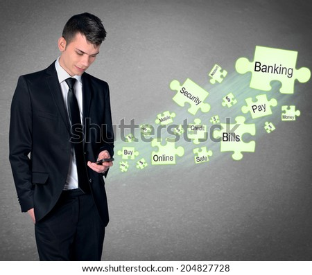 Business man with smartphone and mobile banking - stock photo