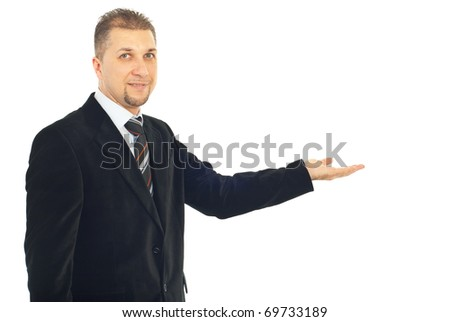 Business man with soft smile making presentation to copy space isolated on white background