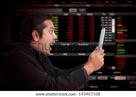 Business man with stock graph report - stock photo