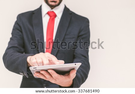 Business man with tablet close up. concept about business and finance - stock photo