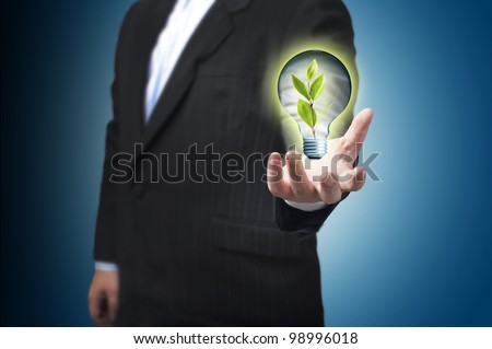 Business man with the digital globe ball floating on his hand. Concept for Global Warming - stock photo