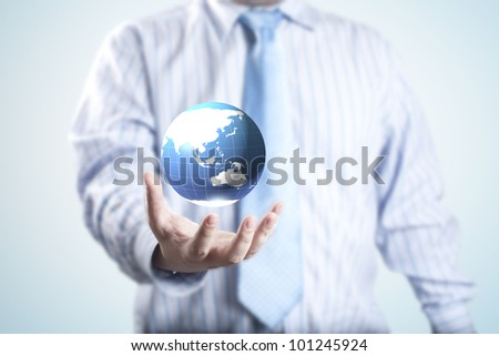 Business man with the digital globe ball floating on his hand. Concept for idea of connectivity within grasp. - stock photo