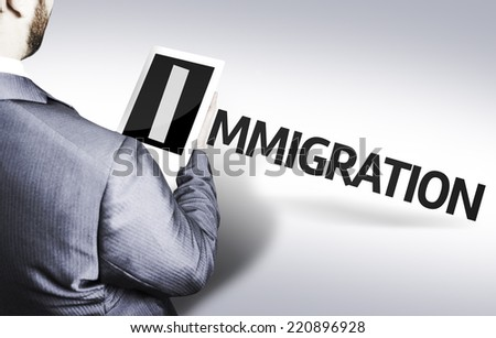 Business man with the text Immigration in a concept image - stock photo