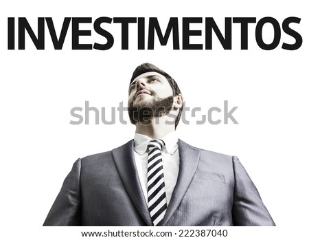 Business man with the text Investment (In Portuguese) in a concept image  - stock photo