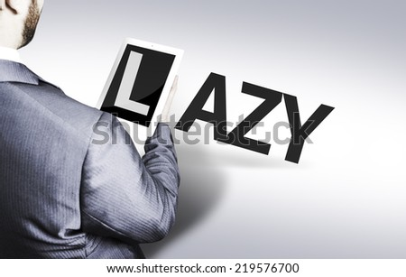 Business man with the text Lazy in a concept image - stock photo
