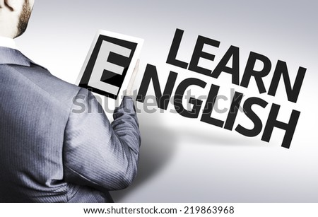 Business man with the text Learn English in a concept image - stock photo