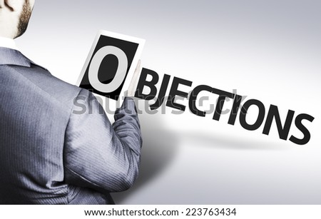 Business man with the text Objections in a concept image - stock photo