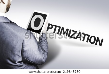 Business man with the text Optimization in a concept image