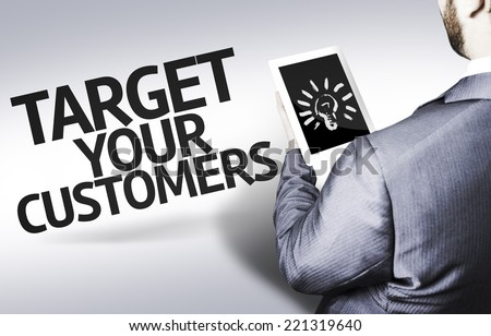 Business man with the text Target your Customers in a concept image - stock photo