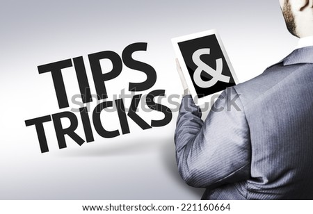 Business man with the text Tips & Tricks in a concept image - stock photo
