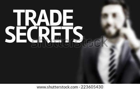 Business man with the text Trade Secrets in a concept image - stock photo