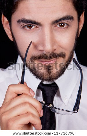 business man with tie and glasses and beard looking serious portrait - stock photo