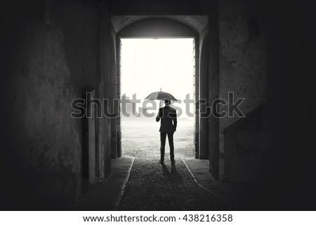 Business Man with umbrella waiting stop raining  - stock photo