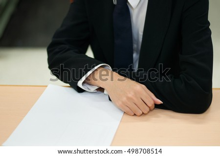 business man with white paper ,on the working desk