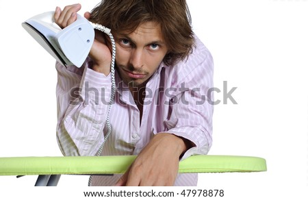 Business man wonders when he can iron his suit - stock photo