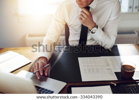 Business man working at office with laptop and documents on his desk, consultant lawyer concept - stock photo