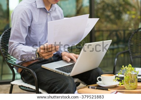 business man working in outdoor using laptop.